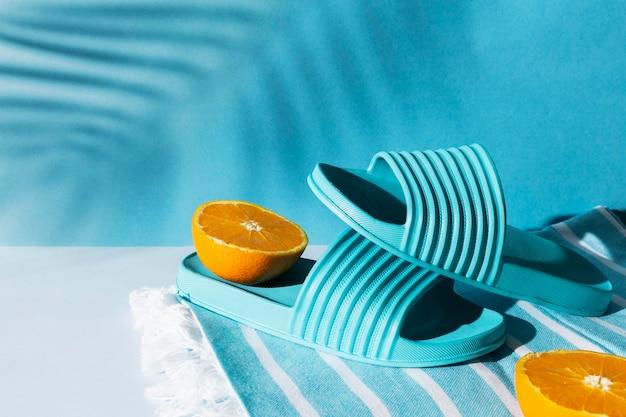 Arrangement with flip flops and orange