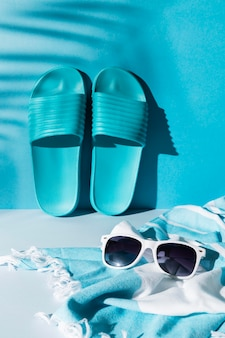 Arrangement with flip flops and sunglasses