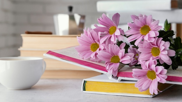 Arrangement with flowers and books