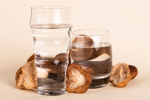 Arrangement with fresh mushrooms and water