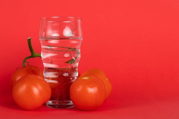 Arrangement with fresh tomatoes and copy-space