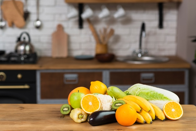 Arrangement with fruits and vegetables in the kitchen