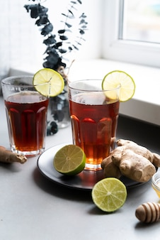Arrangement with glass of tea and lime