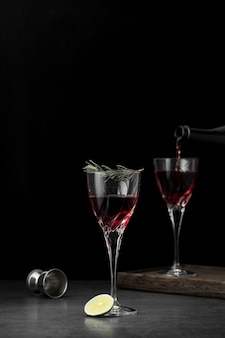 Arrangement with glasses of drink and dark background