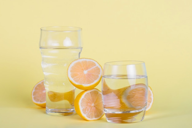 Arrangement with glasses of water and lemons