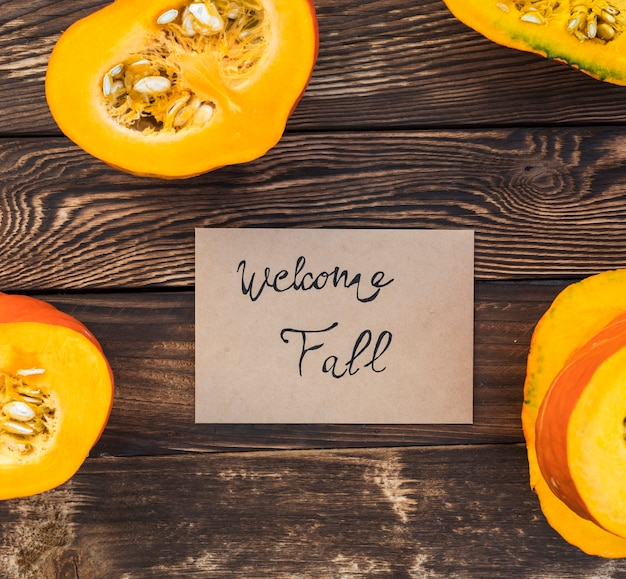 Arrangement with greeting card and cut pumpkin