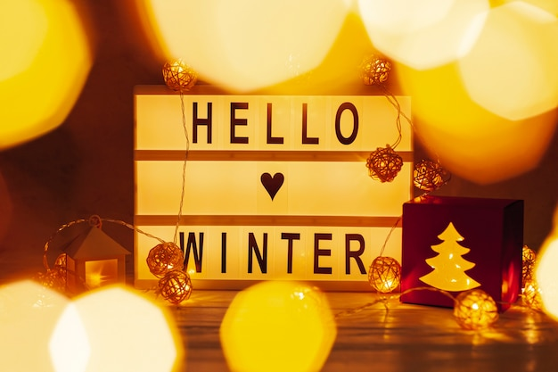 Arrangement with hello winter sign and lights