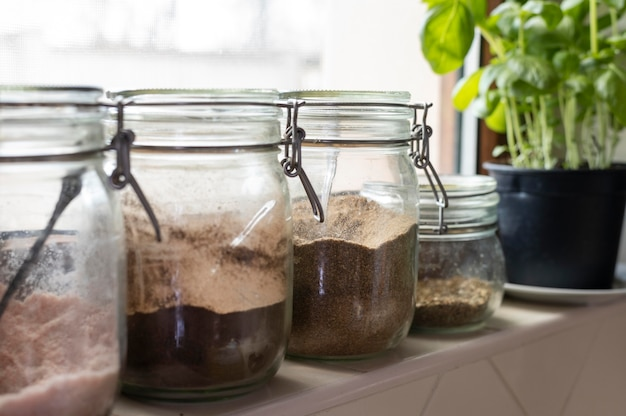 Arrangement with jars and plant Free Photo