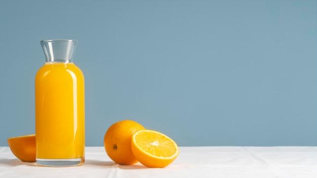 Arrangement with juice and oranges