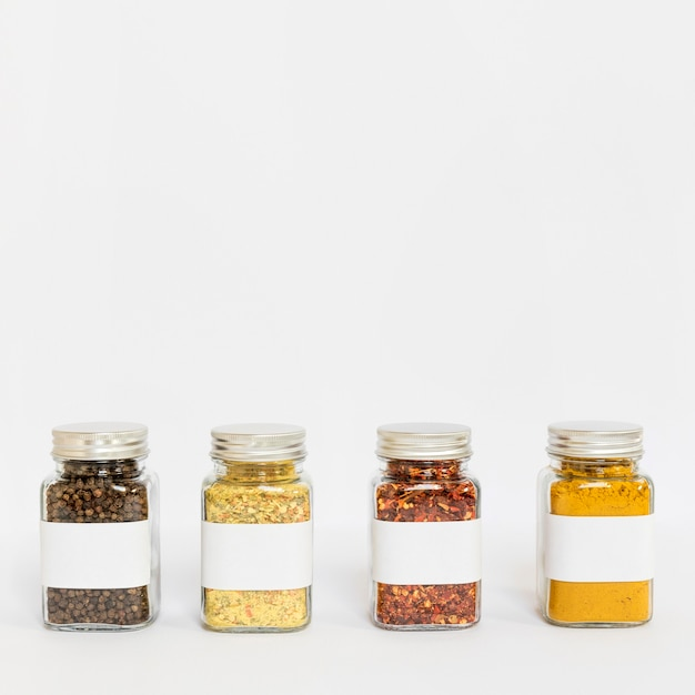 Arrangement with labelled jars and copy-space