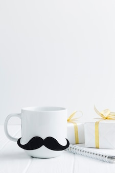 Arrangement with mug and presents