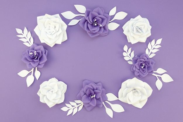 Arrangement with paper flowers and purple background