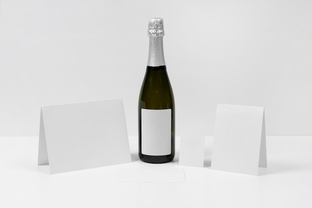 Arrangement with paper pieces and bottle