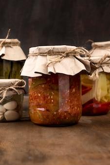 Arrangement with pickled vegetables in jars