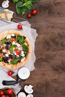 Arrangement with pizza and vegetables
