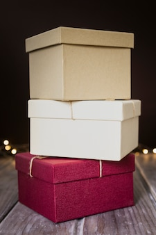Arrangement with present boxes and dark background