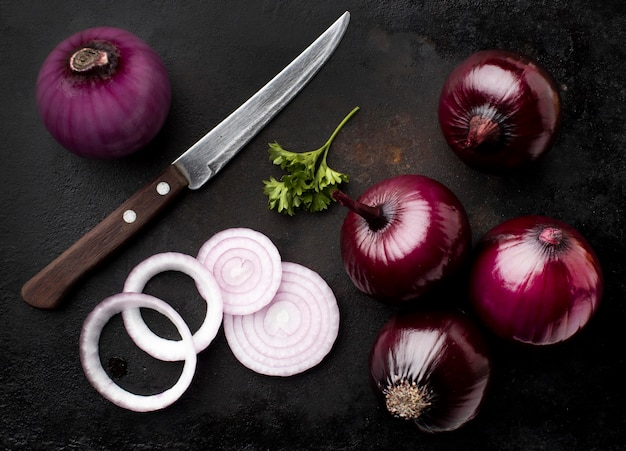 Arrangement with red onions flat lay