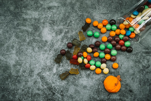 Arrangement with scattered sweets and candy pumpkin