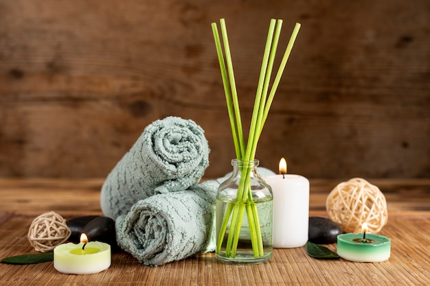Arrangement with spa scented sticks and towels