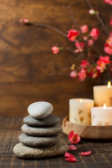 Arrangement with spa stones and lit candles