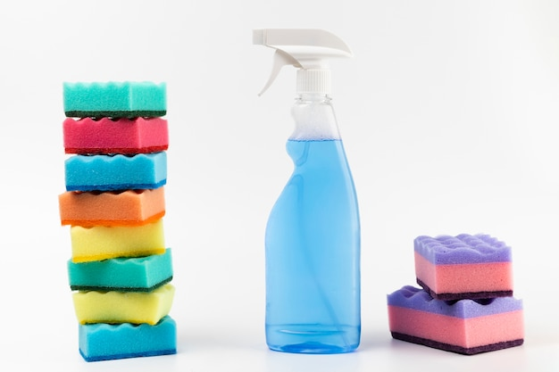 Arrangement with spray bottle and colourful sponges Premium Photo