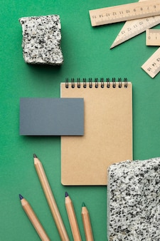 Arrangement with stationery elements on green background