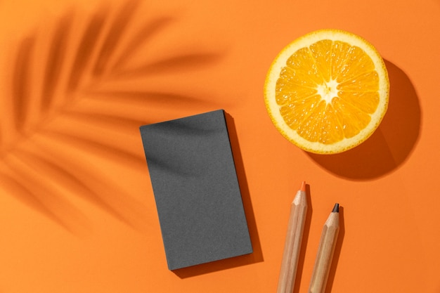 Arrangement with stationery elements and orange
