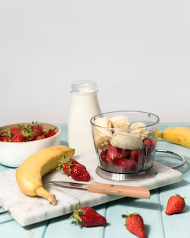 Arrangement with strawberry and banana smoothie