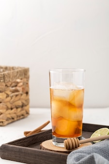 Arrangement with tasty drink and lime slice