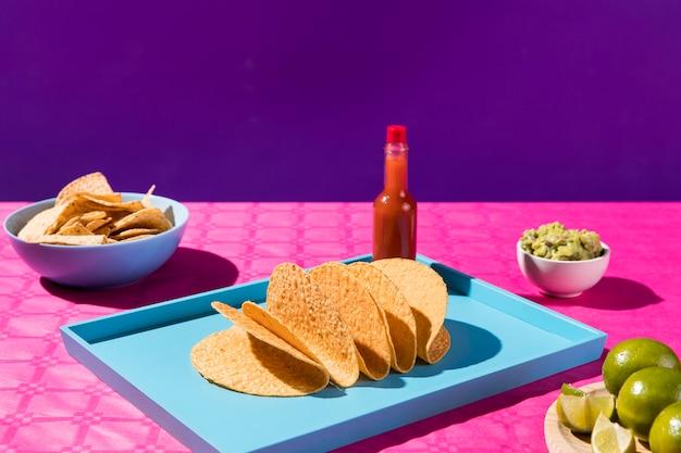Arrangement with tortillas and sauce bottle