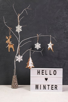 Arrangement with tree and hello winter sign