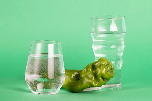 Arrangement with water and fresh pepper