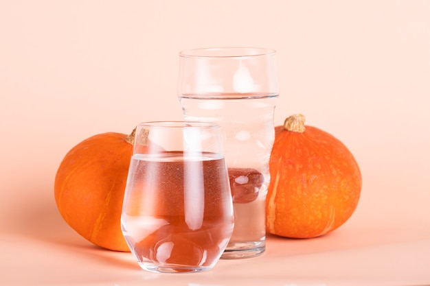 Arrangement with water and pumpkins