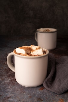 Arrangement with white mugs and marshmallows