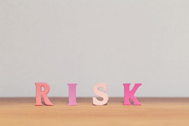 Arrangement wooden letters word risk on table