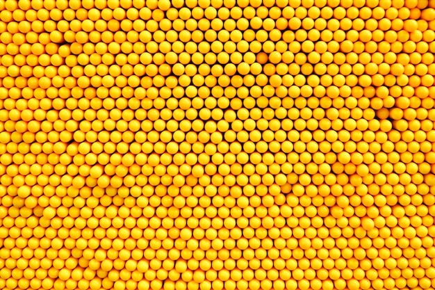 The arrangement of the yellow button is a background.