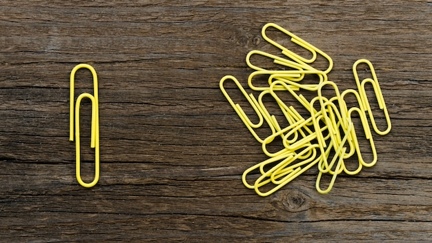 Arrangement of yellow paper clips for individuality concept