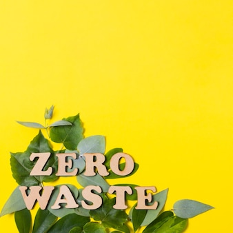 Arrangement of zero waste lettering on leaves with copy space