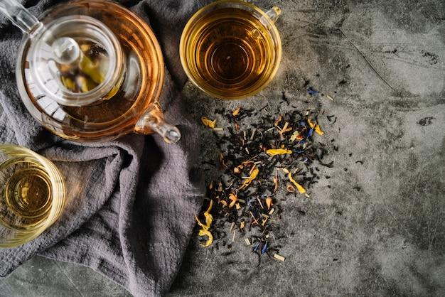 Arrangements of tea cups on cloth top view