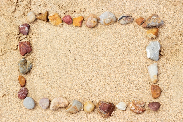 Arranging stone on sand beaach for summer background