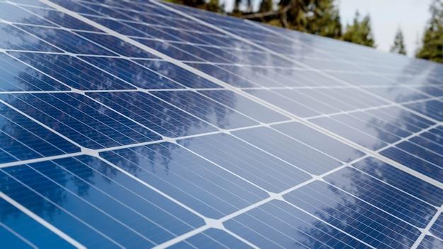Array of solar panels in solar power station field green energy farm