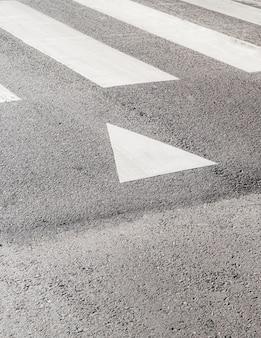 Arrow indicator on asphalt