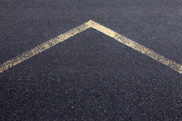 Arrow line on new asphalt road texture