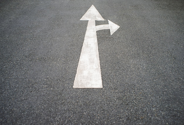 Arrow on the road and white color