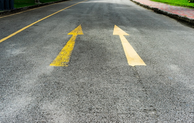 Arrow on the road and yellow color