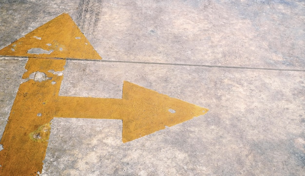 Arrow on the road and yellow colour