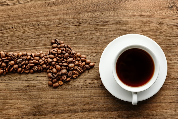 Arrow-shaped coffee beans indicate a cup of coffee.