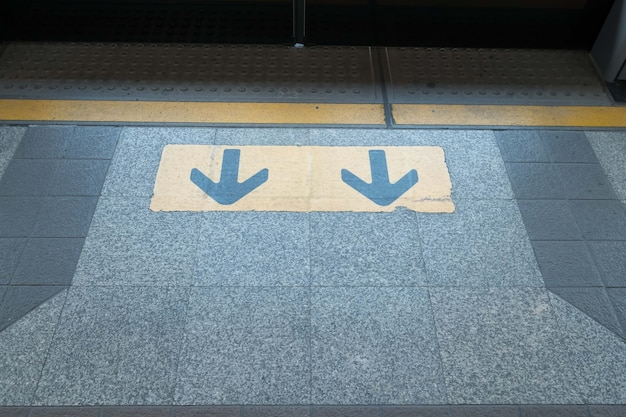 Arrow sign at electric train station