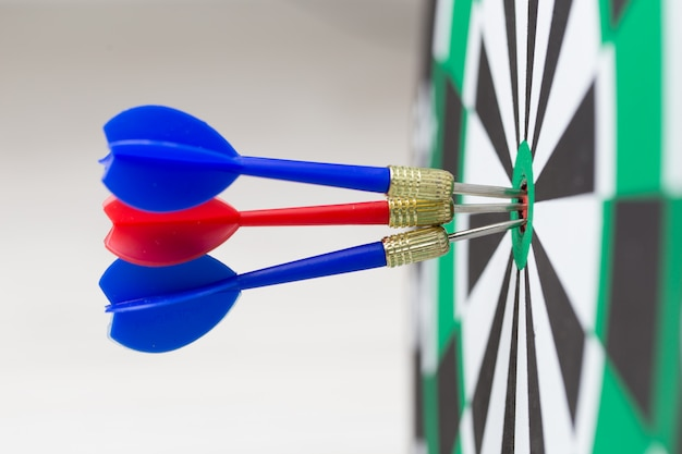 Arrows hitting the center of a target board