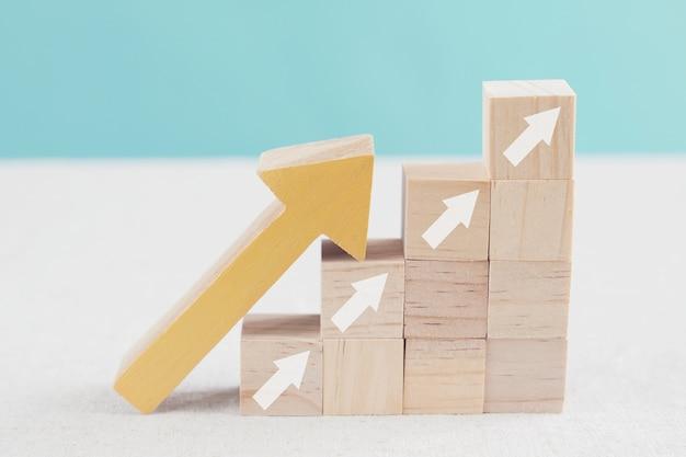 Arrows ladder up on wooden blocks